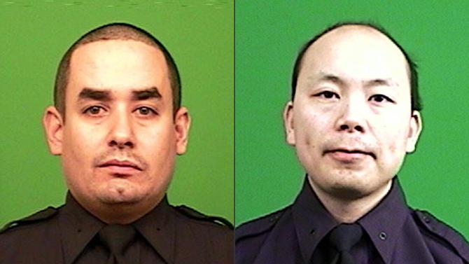 "FILE - This combination made from photos provided by the New York Police Department shows officers Rafael Ramos, left, and Wenjian Liu. Authorities say Ismaaiyl Brinsley, who vowed online to shoot two ""pigs"" in retaliation for the police chokehold death of Eric Garner, ambushed Ramos and Liu in a patrol car Saturday, Dec. 20, 2014, and fatally shot them in broad daylight before running to a subway station and killing himself. The killing of the officers highlighted shortcomings in the warning systems that were used. (AP Photo/New York Police Department, File)"