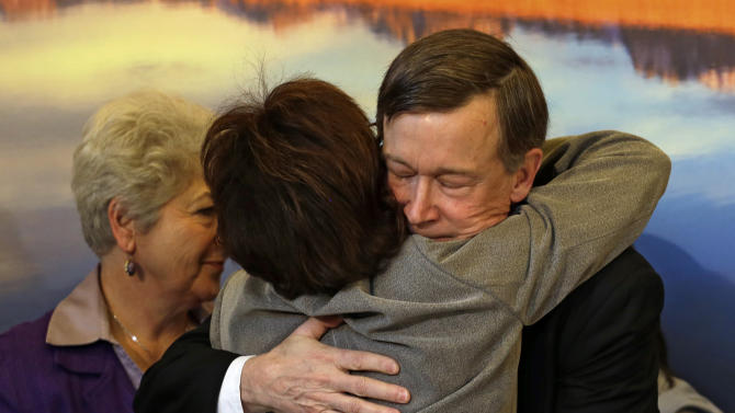 Colorado Gov. John Hickenlooper, right, is hugged by Rep. Rhonda Fields, D-Aurora, after he signed gun control bills into law at the Capitol in Denver on Wednesday, March 20, 2013. Fields was a co-sponsor of bills on background checks and the size of ammunition magazines. (AP Photo/Ed Andrieski, Pool)