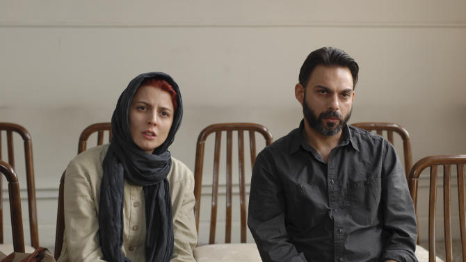 """In this undated photo released by Filmiran film distributing company, Iranian actress Leila Hatami, and actor Peyman Moadi, act in a scene of movie """"A Separation"""" which won the Academy Awards in foreign films. Iran trumpeted the Islamic Republic's first foreign film Oscar win Monday as a triumph over archfoe Israel _ even as audiences in Israel packed theaters to watch the movie that beat their country's entry at the Academy Awards. (AP Photo/Filmiran International Company, Habib Majidi)"""