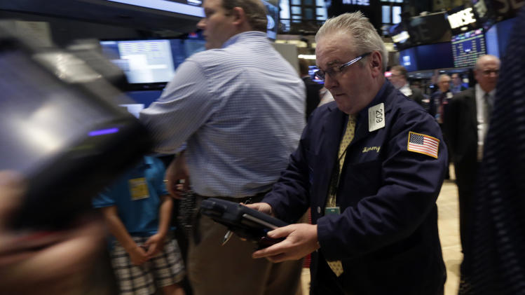 Trader James Dresch, right, works on the floor of the New York Stock Exchange, Monday, June 30, 2014. European stocks were lower Wednesday July 30, 2014 ahead of U.S. economic data while cheery earnings from major Japanese companies such as Honda Motor Co. boosted Asian markets.(AP Photo/Richard Drew)