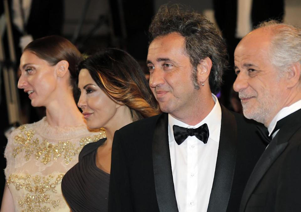 From left, actors Anna Della Rosa, Sabrina Ferilli, director Paolo Sorrentino and actor Toni Servillo arrive for the screening of The Great Beauty at the 66th international film festival, in Cannes, southern France, Tuesday, May 21, 2013. (AP Photo/Lionel Cironneau)
