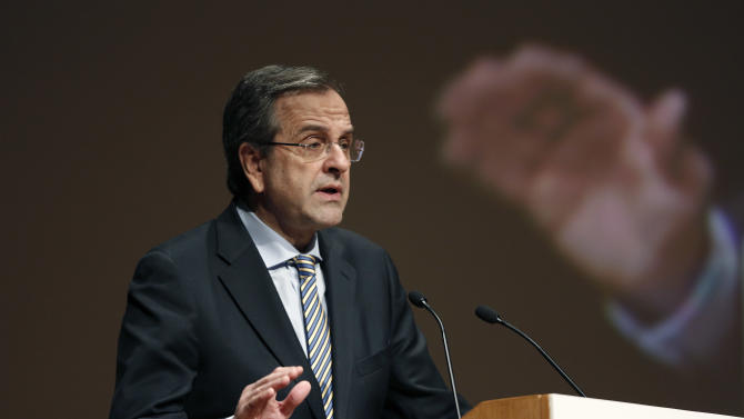 Greek Prime Minister Antonis Samaras speaks at a health conference in Athens on Thursday, Dec. 12, 2013. The two-day conference focuses on reforming Greece's state health sector amid the country's acute debt crisis. (AP Photo/Petros Giannakouris)