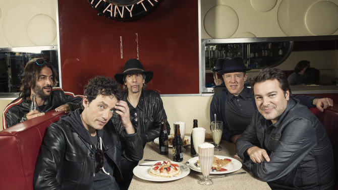 """This Oct. 1, 2012 photo shows members of The Wallflowers, from left, Rami Jaffee, Jakob Dylan, Stuart Mathis, Jack Irons and Greg Richling posing for a portrait at The Meatpacking Diner in New York. The Wallflowers released a new album this month titled, """"Glad All Over."""" (Photo by Victoria Will/Invision/AP Images)"""