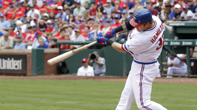 Texas Rangers' Josh Hamilton connects for a solo home run off of Los Angeles Angels starting pitcher C.J. Wilson in the sixth inning of a baseball game Saturday, May 12, 2012, in Arlington, Texas. The shot was Hamilton's 18th of the season in the 4-2 Rangers loss.  (AP Photo/Tony Gutierrez)
