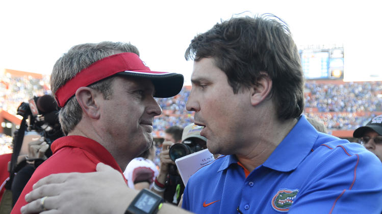 Florida coach Will Muschamp, right, talks with Louisiana-Lafayette coach Mark Hudspeth, left, after Florida won 27-20 in an NCAA college football game in Gainesville, Fla., Saturday, Nov. 10, 2012.  (AP Photo/Phil Sandlin)