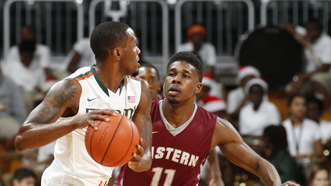 Eastern Kentucky's Jaylen Babb-Harrison (11) defends Miami's JaQuan Newton (0) during the second half of an NCAA college basketball game in Coral Gables, Fla., Friday, Dec. 19, 2014. Eastern Kentucky defeated Miami 72-44. (AP Photo/Joel Auerbach)