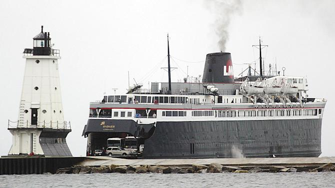 FILE - In this May 12, 2006 file photo the S.S. Badger passes the north breakwater light at Ludington, Mich. On one level, it's a straightforward case of a business seeking a government permit to discharge wastewater. But when the Environmental Protection Agency rules shortly on whether to let the S.S. Badger car ferry continue dumping ash into Lake Michigan, it will be a milestone in a decades-old effort to keep afloat the last coal-fired steamship operating on U.S. waters. (AP Photo/Ludington Daily News, Andy Klevorn, File)