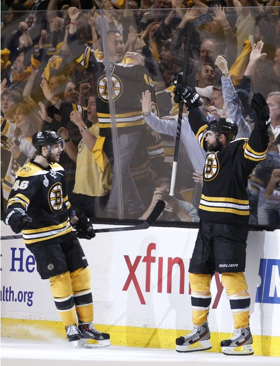 Bruins' Boychuk celebrates his third period goal against the Blackhawks with teammate Krejci in Game 4 of their NHL Stanley Cup Finals hockey series in Boston