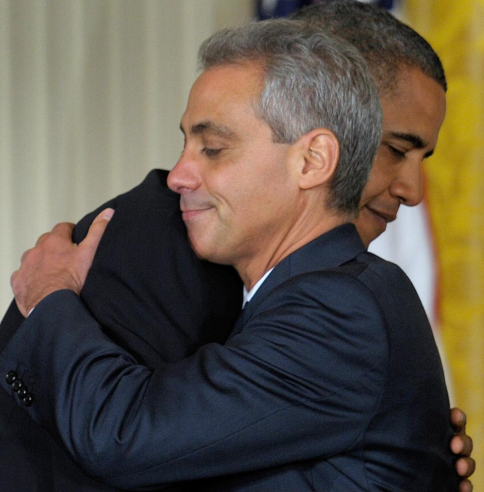 President Barack Obama hugs outgoing White House Chief of Staff Rahm Emanuel in the East Room of the White House in Washington, Friday, Oct. 1, 2010, during an announcement that Emanuel will be stepping down to run for Mayor of Chicago . Obama announced that Pete Rouse will be interim Chief of Staff. (AP Photo/Susan Walsh)
