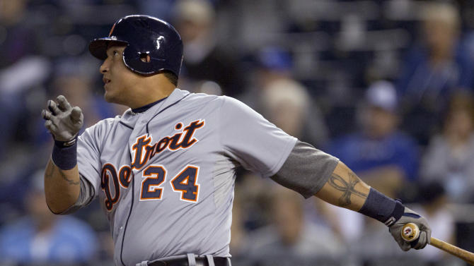 Detroit Tigers' Miguel Cabrera watches his single off Kansas City Royals starting pitcher Jeremy Guthrie during the first inning of a baseball game at Kauffman Stadium in Kansas City, Mo., Tuesday, Oct. 2, 2012. (AP Photo/Orlin Wagner)
