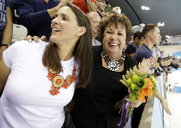 Debbie Phelps, mother of United States swimmer Michael Phelps, and her daughter Hilary smile after Phelps' team won the gold medal un the men's 4 x 200-meter freestyle relay at the Aquatics Centre in