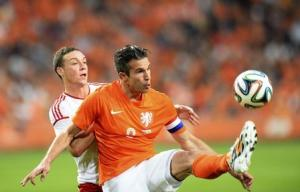 Robin van Persie of the Netherlands fights for the ball with James Chester of Wales during their international friendly soccer match in Amsterdam