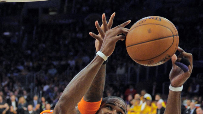 Phoenix Suns center Jermaine O'Neal, left, and Los Angeles Lakers forward Antawn Jamison battle for a rebound during the first half of their NBA basketball game, Friday, Nov. 16, 2012, in Los Angeles. (AP Photo/Mark J. Terrill)