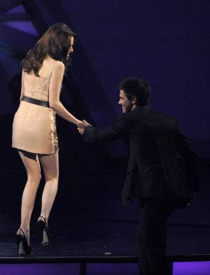 "Kristen Stewart, left, and Taylor Lautner accept the award for favorite onscreen team for ""The Twilight Saga: Eclipse"" at the People's Choice Awards on Wednesday, Jan. 5, 2011, in Los Angeles. (AP Photo/Chris Pizzello)"