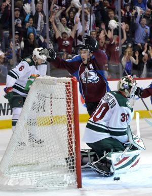 Colorado Avalanche center Paul Stastny (26) celebrates scoring the game winning goal against Minnesota Wild goalie Ilya Bryzgalov (30) from Russia as Marco Scandella (6) reacts during the fourth period in Game 1 of an NHL hockey first-round playoff series on Thursday, April 17, 2014, in Denver. Colorado beat Minnesota 5-4 in overtime. (AP Photo/Jack Dempsey)