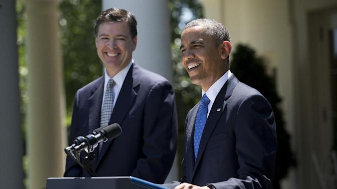 President Barack Obama smiles as he announces the nomination of James Comey, left, a senior Justice Department official under President George W. Bush, to replace Robert Mueller as FBI director, Friday, June 21, 2013, in the Rose Garden of the White House in Washington. (AP Photo/Evan Vucci)