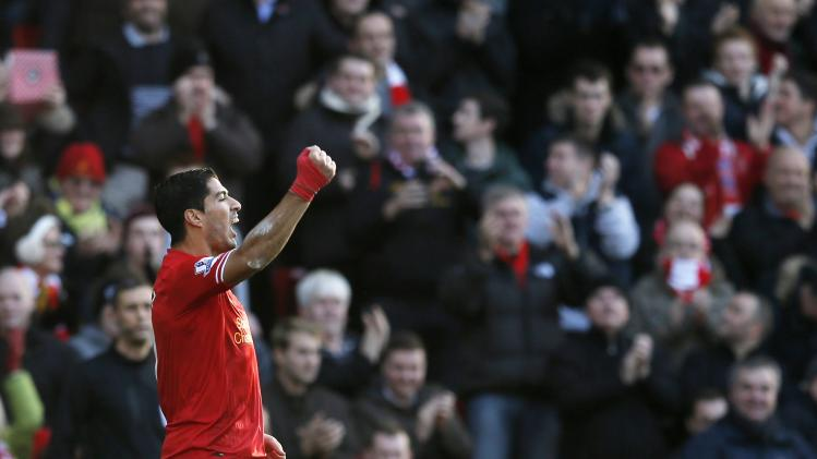 Liverpool's Suarez celebrates after scoring a goal against Cardiff City during their English Premier League soccer match at Anfield in Liverpool