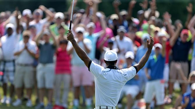Tiger Woods celebrates with the crowd after making birdie on the third green during the second round of the Tour Championship golf tournament at East Lake Golf Club in Atlanta, Friday, Sept. 20, 2013. .(AP Photo/Atlanta Journal-Constitution, Jason Getz) MARIETTA DAILY OUT; GWINNETT DAILY POST OUT; LOCAL TV OUT; WXIA-TV OUT; WGCL-TV OUT
