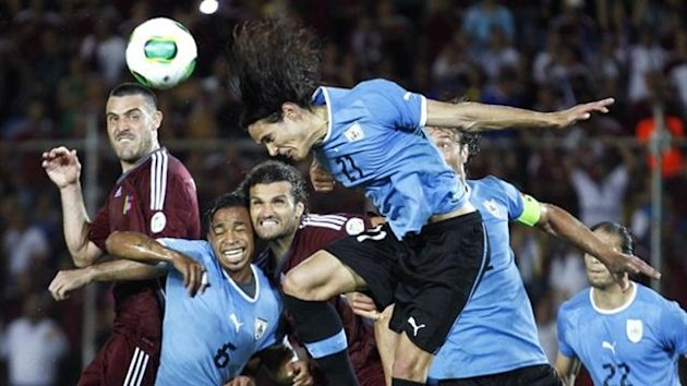 Uruguay's Edinson Cavani (21) heads after a corner shot during their 2014 World Cup qualifying match against Venezuela (Reuters)