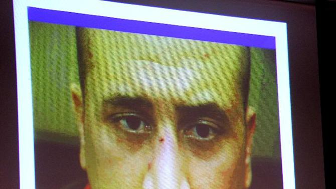 A photo of George Zimmerman taken at the Sanford police station on the night of the Trayvon Martin shooting is projected on a video monitor for the jury during the 16th day of his trial in Seminole circuit court, in Sanford, Fla., Monday, July 1, 2013. Zimmerman has been charged with second-degree murder for the 2012 shooting death of Trayvon Martin.(AP Photo/Orlando Sentinel, Joe Burbank, Pool)