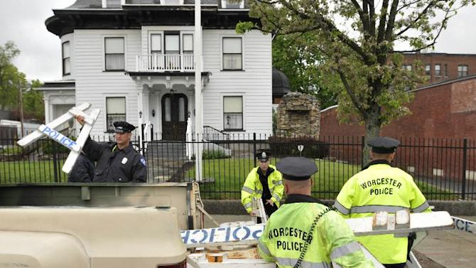 Worcester police remove barricades from in front of the Graham Putnam & Mahoney funeral home in Worcester, Mass.,  on Thursday, May 9, 2013.  Boston Marathon bombing suspect Tamerlan Tsarnaev has been buried in an undisclosed location outside the city of Worcester, police said Thursday after a frustrating weeklong search for a community willing to take the body. Tsarnaev's body had been at the Graham Putnam & Mahoney Funeral Parlors.  Sgt. Kerry Hazelhurst said the body was no longer in Worcester and is now entombed. Police did not specify where the body was taken.  (AP Photo/Worcester Telegram & Gazette, Paul Kapteyn)