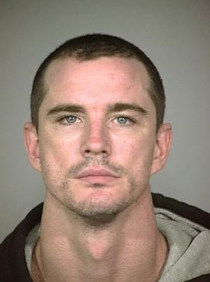 FILE - This 2006 photo provided by the Indianapolis Metro Police Dept, shows Christopher Allen Carlson, Carlson, an Indiana man convicted of forcing his young grandsons to hike for miles along a sun-baked Grand Canyon hiking trail and denied them water and food, is scheduled to be sentenced in Phoenix on Thursday, June 14, 2012. (AP Photo/Indianapolis Metro Police Dept, File)