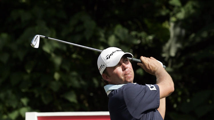 Bo Van Pelt of the United States watches his shot on the first hole during round three of CIMB Classic golf tournament at the Mines Resort and Golf Club in Kuala Lumpur, Malaysia, Saturday, Oct. 27, 2012.  (AP Photo/Peter Lim)