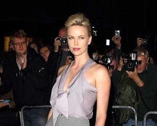 Charlize Theron goes for 70s style pants at the GQ Men of the Year Awards