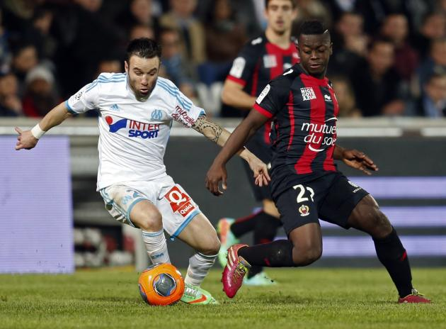 Olympique Marseille's Valbuena challenges Nice's Mendy during their French Ligue 1 soccer match in Marseille