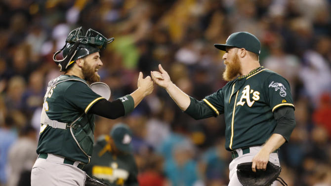 Lowrie draws bases-loaded walk in 10th to lift A's