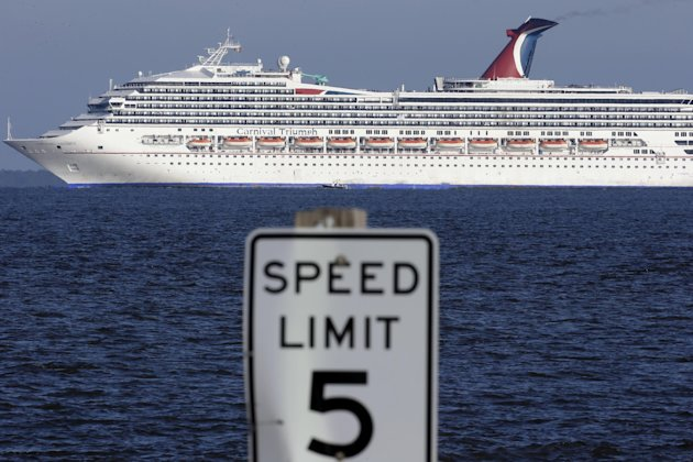 The cruise ship Carnival Triumph into Mobile Bay near Dauphin island, Ala., Thursday, Feb. 14, 2013.  The ship with more than 4,200 passengers and crew members has been idled for nearly a week in the