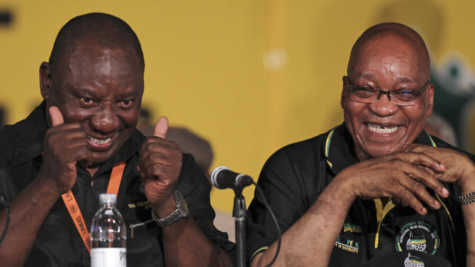 African National Congress (ANC) re-elected President Jacob Zuma, right, with his new deputy Cyril Ramaphosa, left, during their elective conference at the University of the Free State in Bloemfontein, South Africa, on Tuesday, Dec. 18, 2012. (AP Photo/Themba Hadebe)