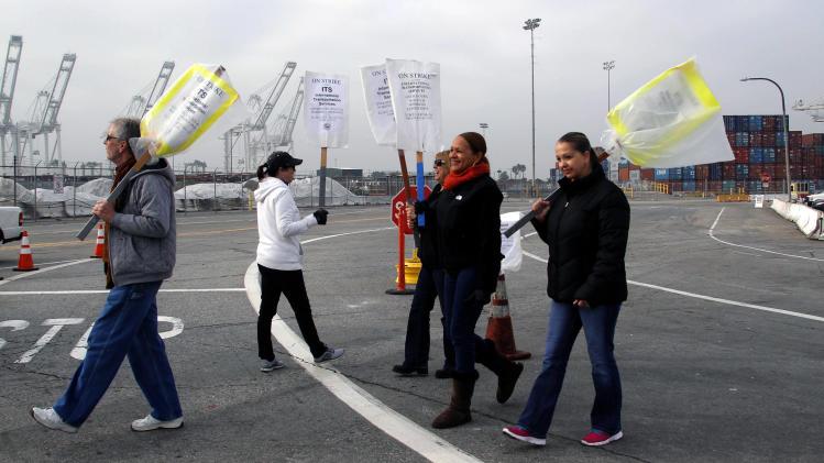Employers: LA port workers to return Wednesday