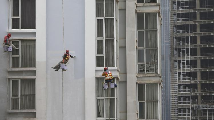 Workers paint the facade of residential buildings in Kunming