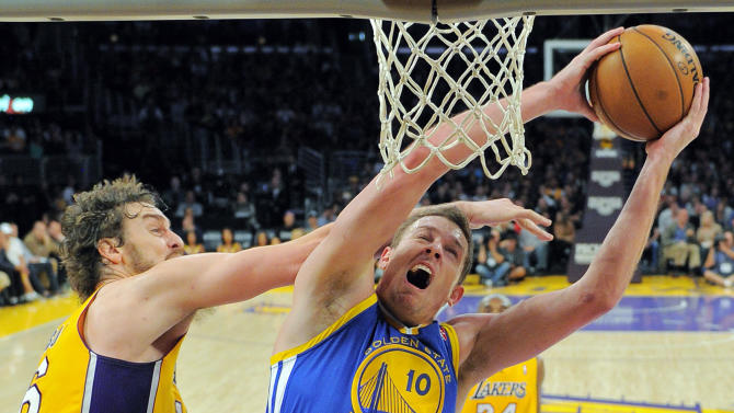 Golden State Warriors forward David Lee, right, goes up for a shot as Los Angeles Lakers forward Pau Gasol, of Spain, defends during the first half of their NBA basketball game, Friday, Nov. 9, 2012, in Los Angeles. (AP Photo/Mark J. Terrill)