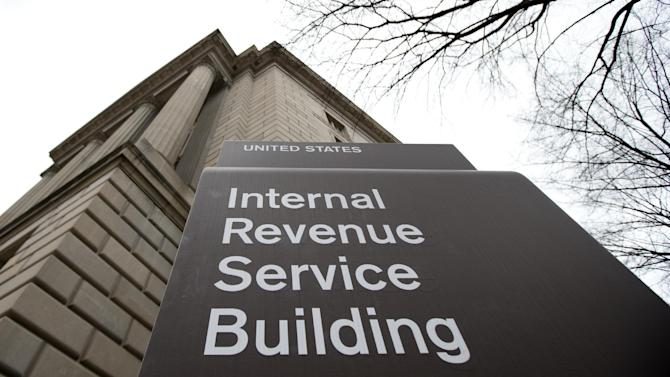 This photo taken March 2, 2013, shows the Internal Revenue Service building at the Federal Triangle complex in Washington, Saturday, March 2, 2013. According to projections by the Tax Policy Center, a research organization based in Washington, wealthy families are paying some of their biggest federal tax bills in decades, even as the rest of the population continues to pay at historically low rates. And a new analysis by the Congressional Budget Office shows that average tax bills for high-income families have rarely been higher since the Congressional Budget Office began tracking the data in 1979, while middle- and low-income families aren't paying as much as they used to. (AP Photo/ roomManuel Balce Ceneta)