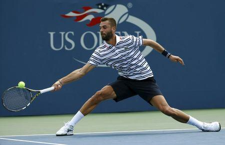 Paire of France hits a return against Nishikori of Japan during their match at the U.S. Open Championships tennis tournament in New York