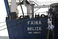 MV Faina&#39;s owner Zadim Alperin (bottom) inspects the ship on February 12, 2009 after its release by Somali pirates. Mohamed Abdi Hassan&#39;s men were reportedly involved in the 2009 capture of the MV Faina, a Ukrainian transport ship carrying 33 refurbished Soviet-era T-72 battle tanks, and which was released after a 134-day hijack for a reported $3 mn