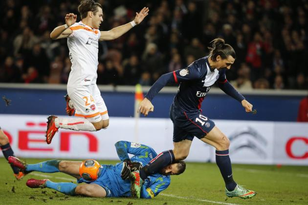 Paris Saint Germain's Zlatan Ibrahimovic fights for the ball with Valenciennes' Nicolas Penneteau during their French Ligue 1 soccer match soccer match at Parc des Princes Stadium in Paris