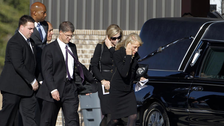 Kansas City Chiefs chairman Clark Hunt, third from right, leaves a funeral service for Kasandra Perkins at Ridgeview Family Fellowship Church Thursday, Dec. 6, 2012, in Blue Ridge, Texas. Perkins was shot and killed last Saturday by her boyfriend Jovan Belcher, a Chiefs football player. AP Photo/Tony Gutierrez)
