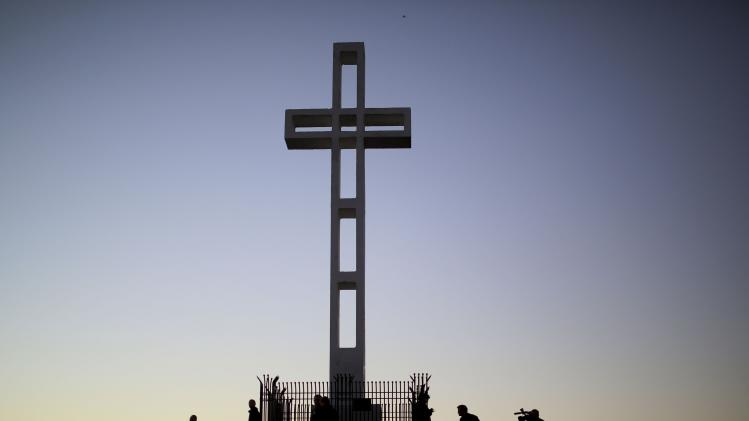 A massive cross sits atop the Mt. Soledad War Memorial in La Jolla