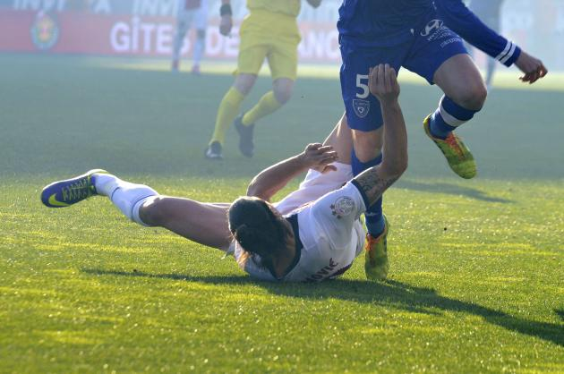 Bastia's Squilacci collides with Paris Saint-Germain's Ibrahimovic who crashes to the ground during their French Ligue 1 soccer match at the Stade Armand-Cesari in Furiani