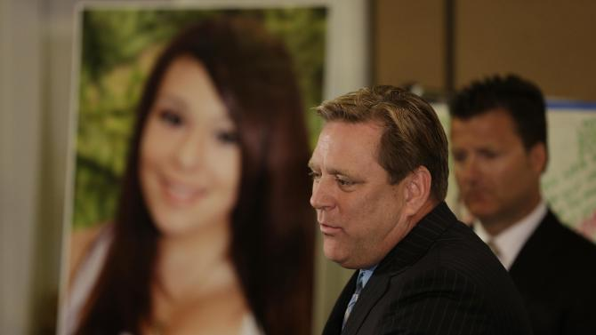 Larry Pott, father of Audrie Pott, who committed suicide after a sexual assault, talks about his daughter during a news conference Monday, April 15, 2013, in San Jose, Calif. At right is family representative Robert Allard. The family of a girl who committed suicide after she was sexually assaulted and a photo of the act was shared in text messages said Monday the three 16-year-old boys responsible were sober when the assault happened.   (AP Photo/Eric Risberg)