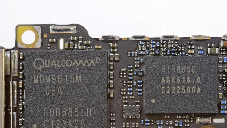 Handout image released by iFixit.com shows the Qualcomm MDM9615M chip on a board of a new iPhone 5 in Melbourne