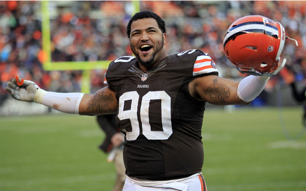 Cleveland Browns defensive lineman Billy Winn celebrates after the Browns won 20-14 in an NFL football game against the Pittsburgh Steelers Sunday, Nov. 25, 2012, in Cleveland. (AP Photo/Tony Dejak)