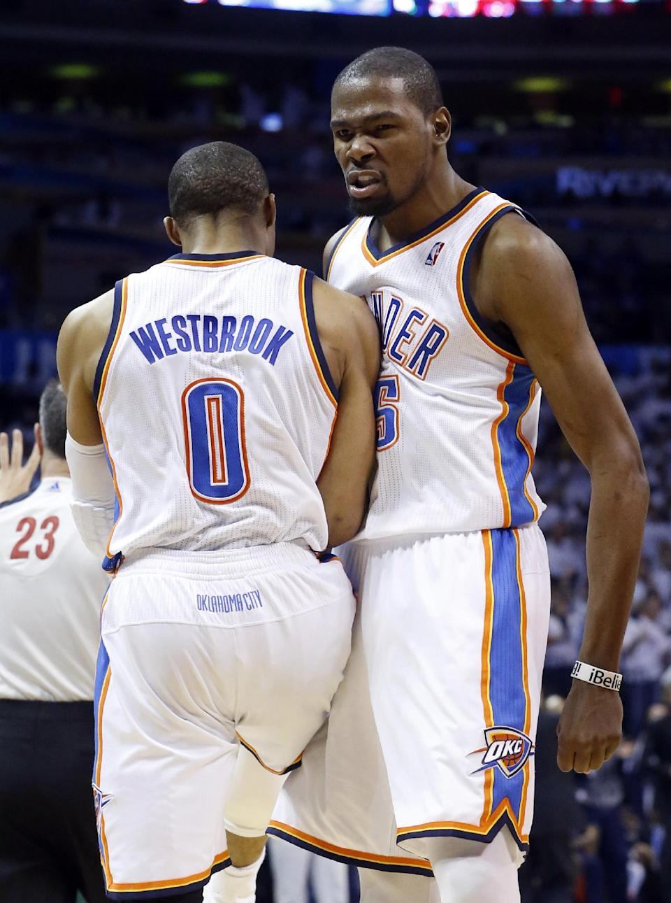 Oklahoma City Thunder forward Kevin Durant (35) bumps chests with teammate Russell Westbrook (0) in the third quarter of Game 2 in their first-round NBA basketball playoff series against the Houston Rockets in Oklahoma City, Wednesday, April 24, 2013. Oklahoma City won 105-102. (AP Photo/Sue Ogrocki)