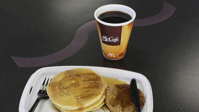 FILE- In this Feb. 14, 2013, photo, a McDonald's breakfast is arranged for an illustration at a McDonald's restaurant in New York. McDonald's says its breakfast menu will be available all day starting Oct. 6, 2015. (AP Photo/Mark Lennihan, File)