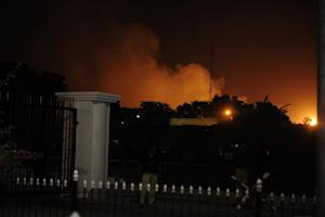 Smoke rises from the burning site of Jinnah International …