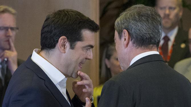 Greek Prime Minister Alexis Tsipras talks with European Central Bank President Mario Draghi during a euro zone EU leaders emergency summit on the situation in Greece in Brussels