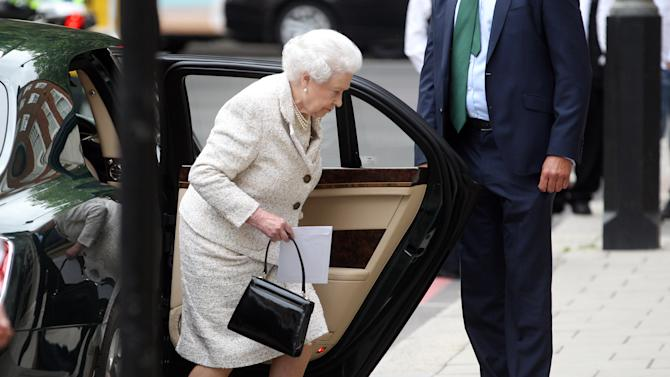 """Britain's Queen Elizabeth II arrives at the London Clinic, Monday June 10, 2013, in central London, where her husband the Duke of Edinburgh is recuperating following an operation on his abdomen. The Duke of Edinburgh is """"comfortable and in good spirits"""" following the exploratory operation, Buckingham Palace said early Monday evening. (AP Photo/PA, Lewis Whyld)  UNITED KINGDOM OUT  NO SALES  NO ARCHIVE"""